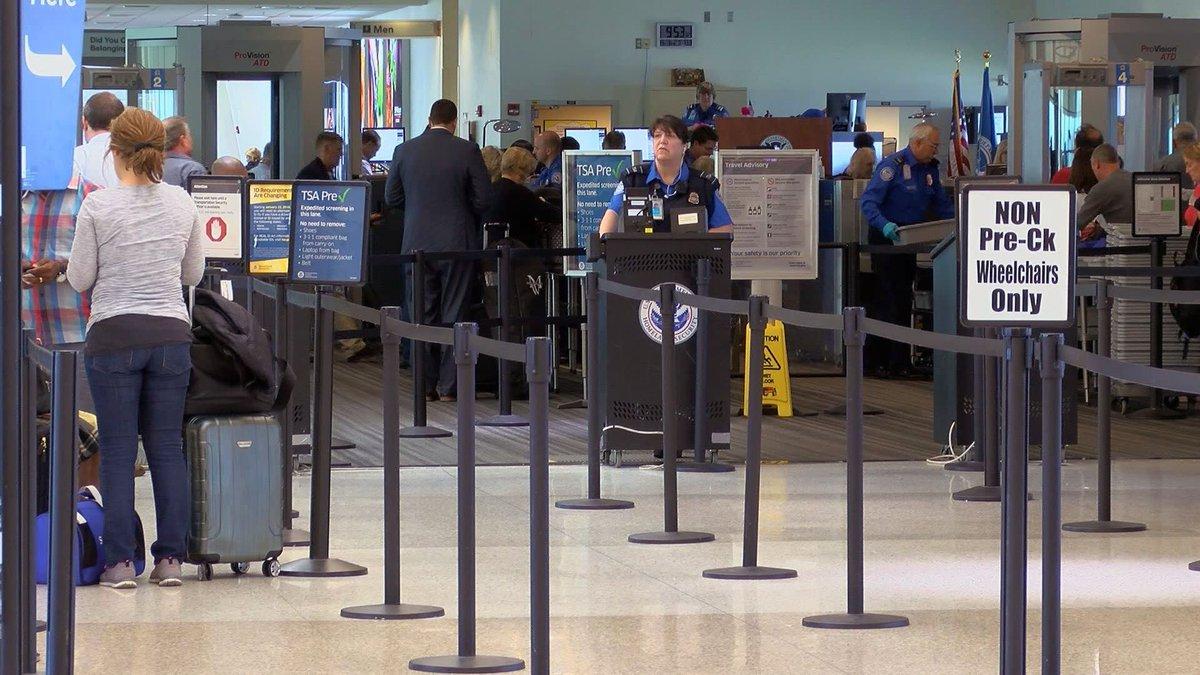 TSA employees at work in Louisville International Airport.