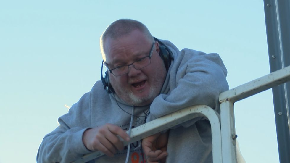 At 6 a.m. Nov. 19, Q103's morning show host Gator Glass went up in a lift at the UAW 862 Union...