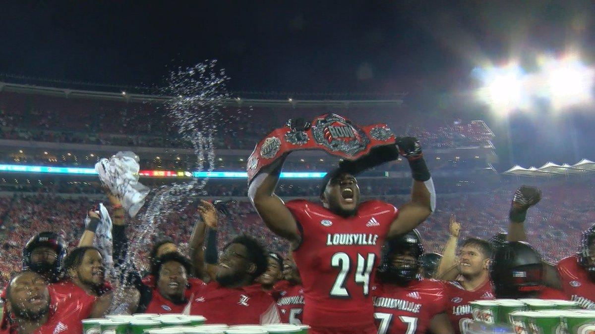 UofL freshman Jaylin Alderman celebrates game-winning interception that he returned for a...