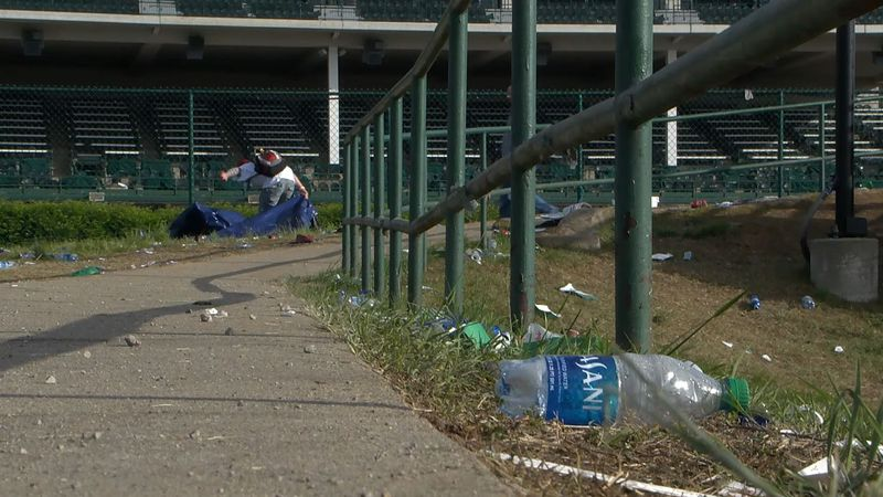 High school students earning money for their sports programs picked up trash left behind by...