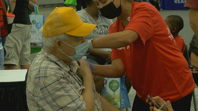 Kentucky State Fair attendees get their COVID-19 vaccine at a UofL mobile clinic