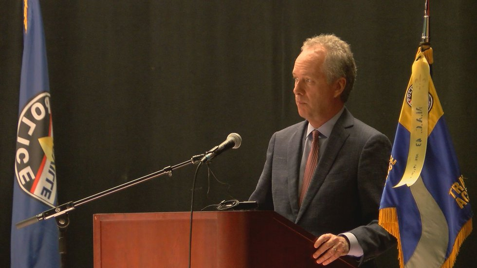 Mayor Greg Fischer addresses the new officers and their guest at the graduation of Metro...