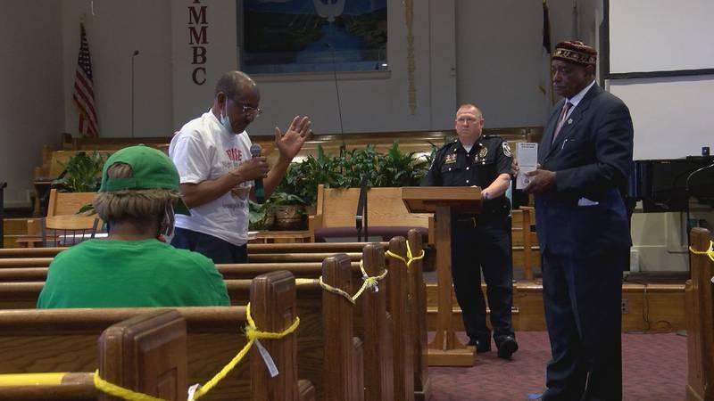 LMPD Major Steve Healy meets with local pastors.