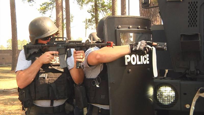 SWAT teams work to secure scene at simulated anti-terrorism training; Source: KALB