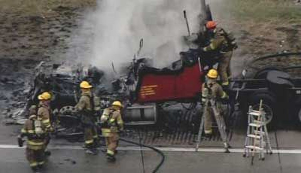 The semi was fully engulfed in flames by the time firefighters arrived.
