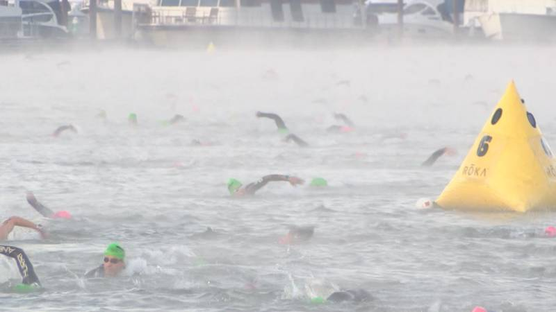Swimmers in the Ohio River for the first leg of the Ironman Triathlon.