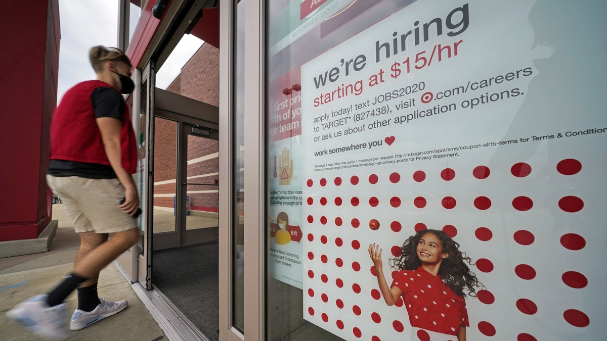 This is a help wanted sign on the door of a Target store in Uniontown, Pa., on Wednesday, Sept....
