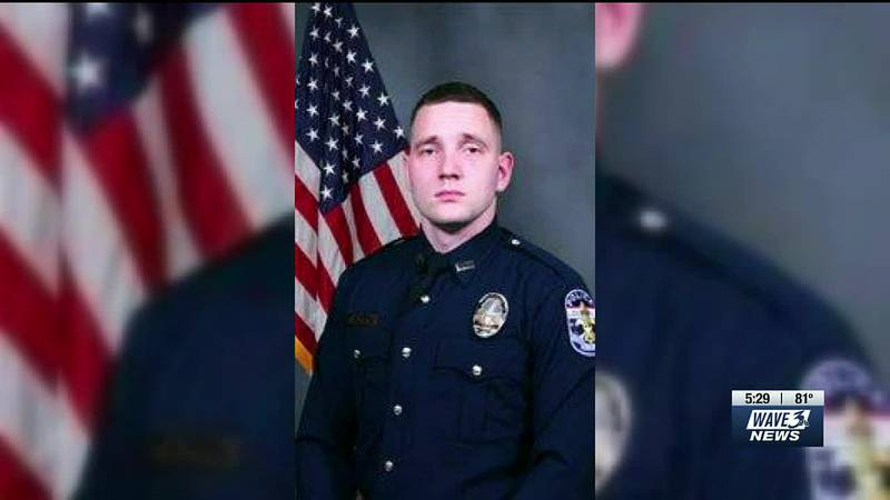Cory Evans, the LMPD officer accused of hitting a protester in the back of the head with a riot...