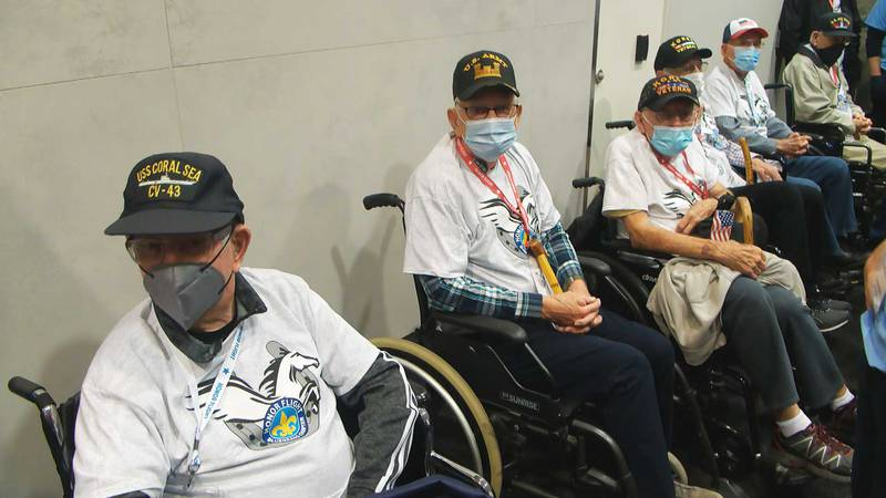 A group of military veterans waiting to board an airplane for a trip to Washington, D.C. as the...