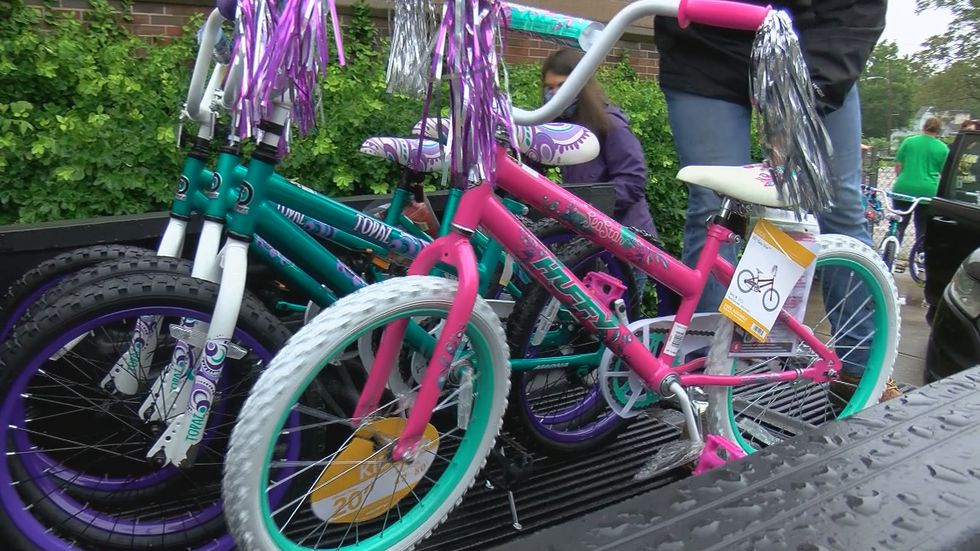 First grade teachers at Byck Elementary collected bikes, helmets, food and summer toys along...