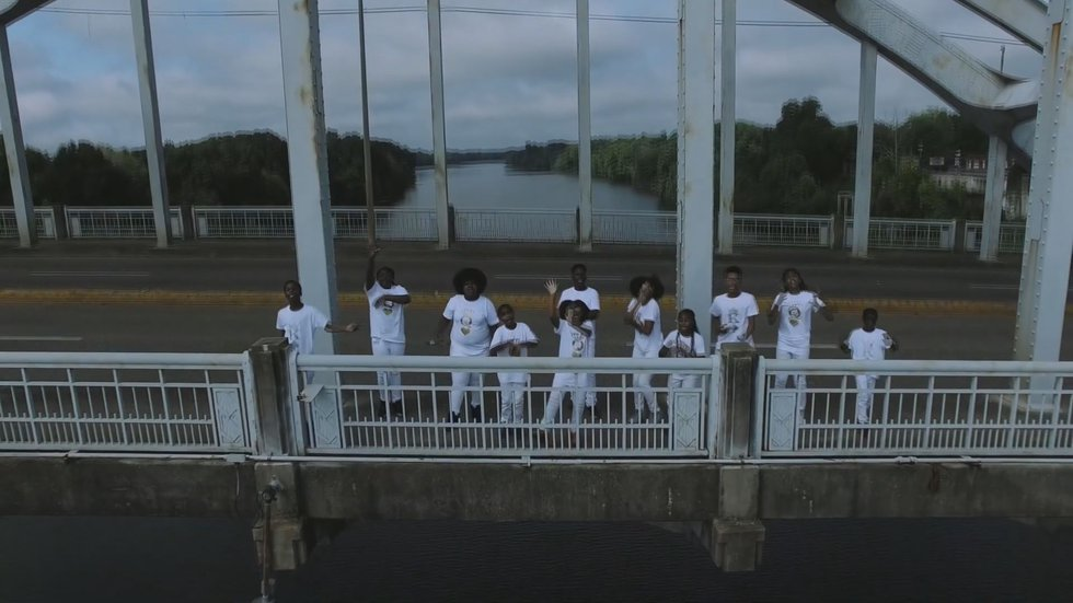The 14 students in Real Young Prodigys created the music video after a visit to Alabama over...