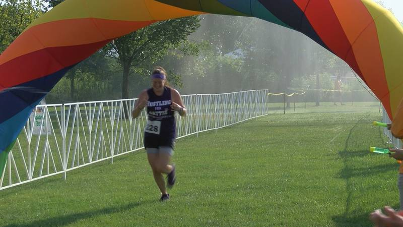 Participants ran through different splash zones and water stations throughout the course, which...
