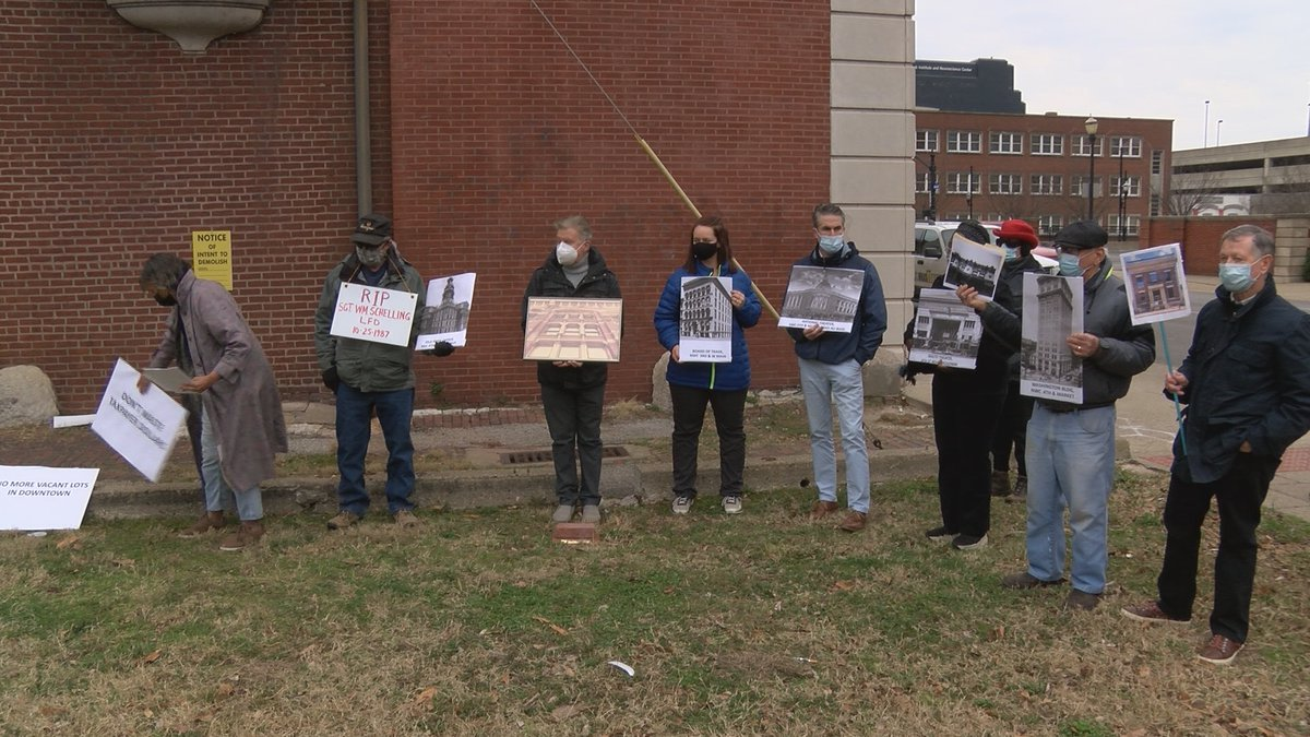The group gathered at the Odd Fellows building to rally against its demolition.