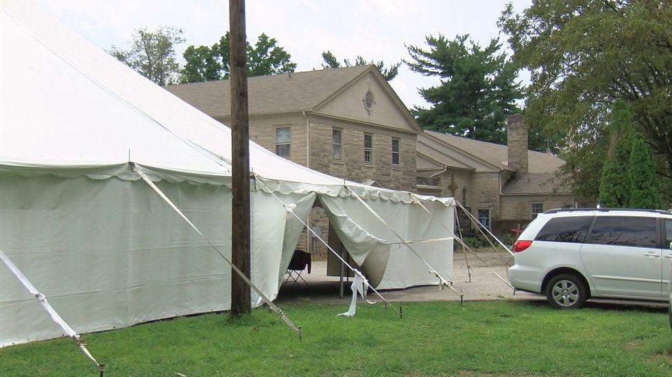There are large tents on the church's property where people can stay.