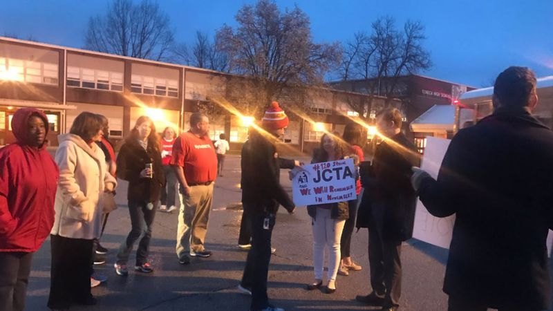 Seneca High School teachers showed up for work Monday, but chanted in protest on the way inside...