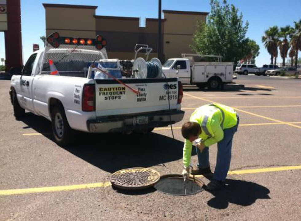 Pest control crews on contract with the county are spraying the sewer system to control...