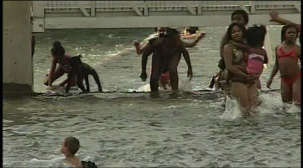 A lot of people played in the water despite warning signs.