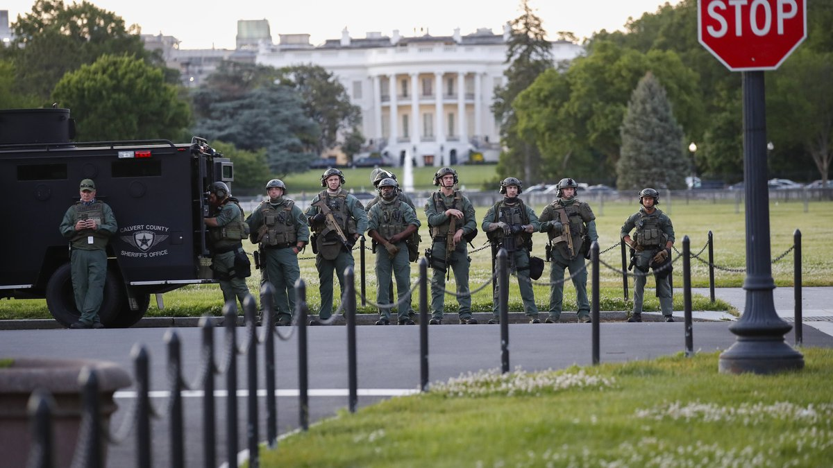 Law enforcement officers from Calvert County Maryland Sheriff's Office standing on the Ellipse,...