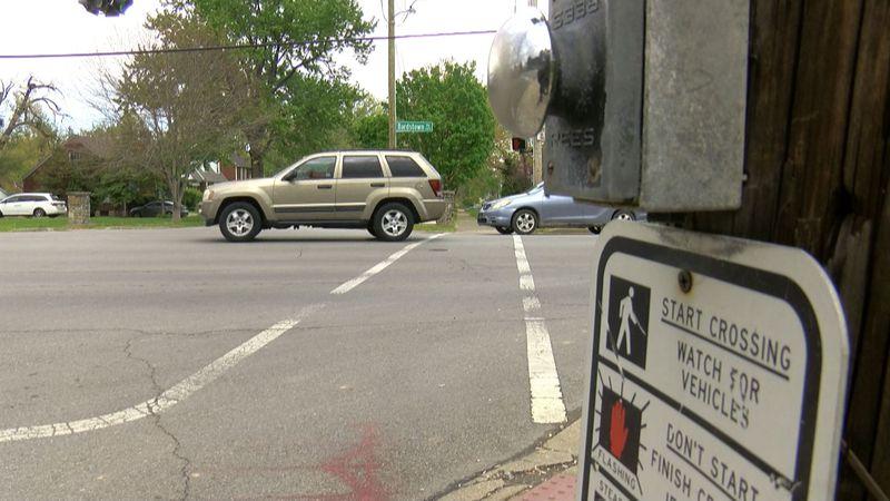 Woman shot, followed while driving near Louisville high school, police say