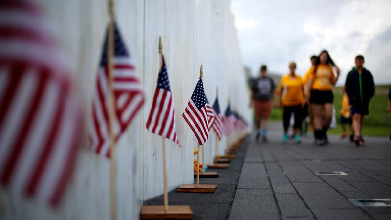 FILE- In this May 31, 2018 file photo, visitors to the Flight 93 National Memorial pause at the...