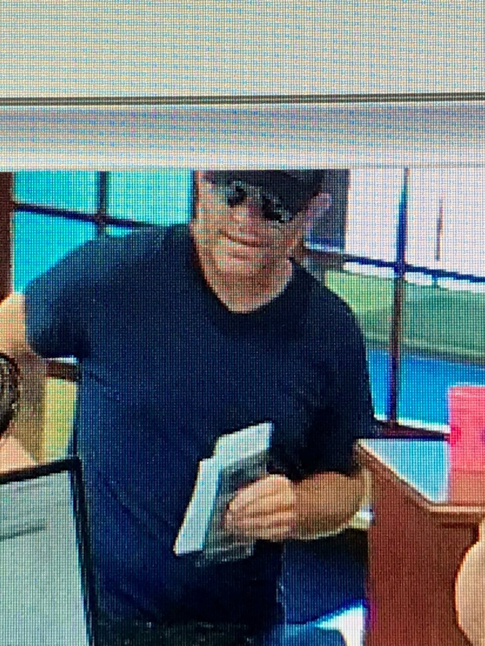 Police said the suspect didn't have a weapon during the robbery at First Savings Bank in...