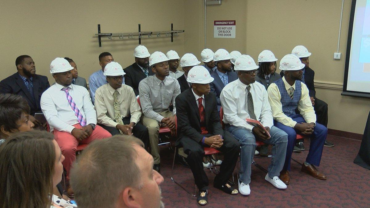 Eighteen men and women graduated from the Kentuckiana Builds program.