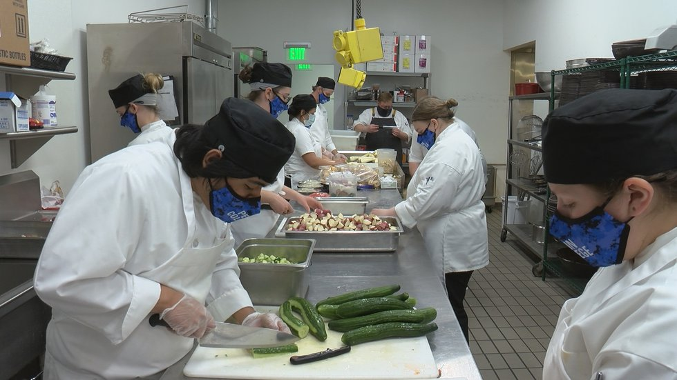 Culinary students prep vegetables that will be used for dishes at Churchill Downs during Derby...