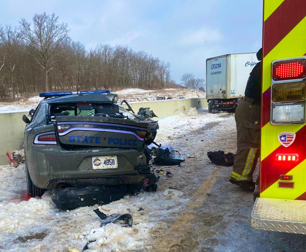 Two Kentucky State Police troopers investigating an accident on Interstate 65 have been injured...