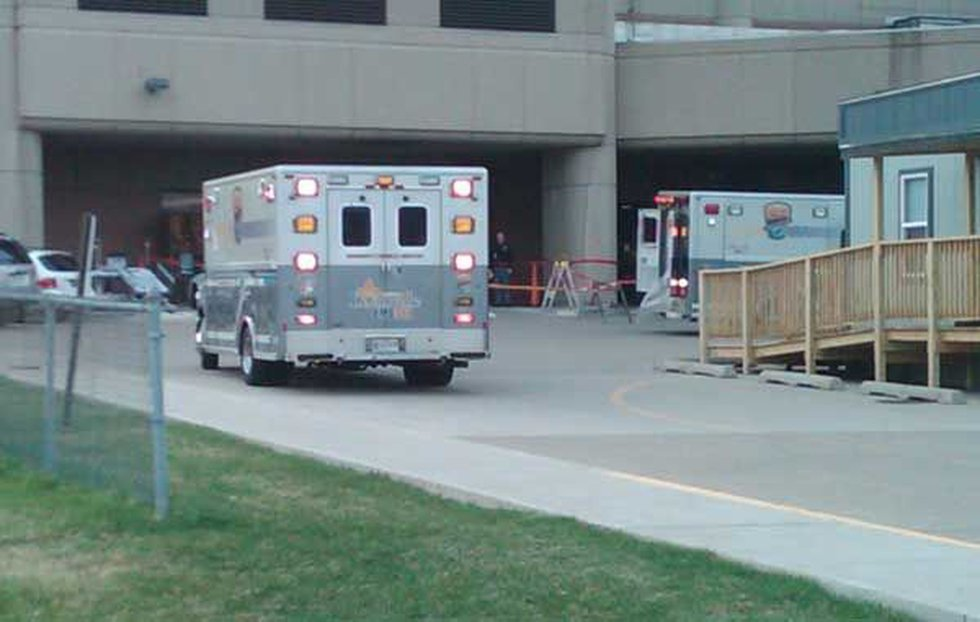 Ambulance arriving at University Hospital with victims for chemical plant explosion