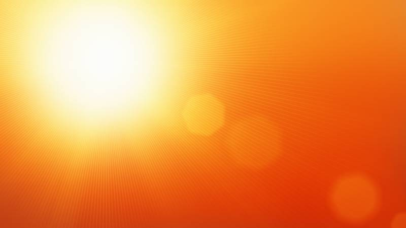 Glory of the sun in a hot summer sky.
