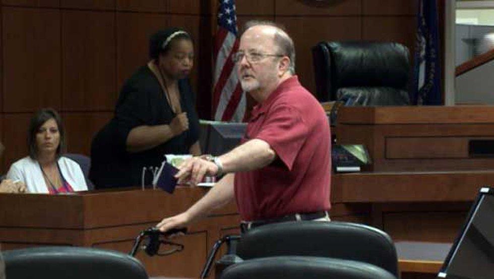 James Schook prepares to be taken into custody after his sentencing.