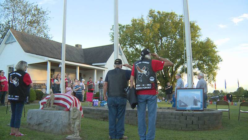 Members of Kentucky's fifth chapter of the Rolling Thunder stand at attention for the Star...