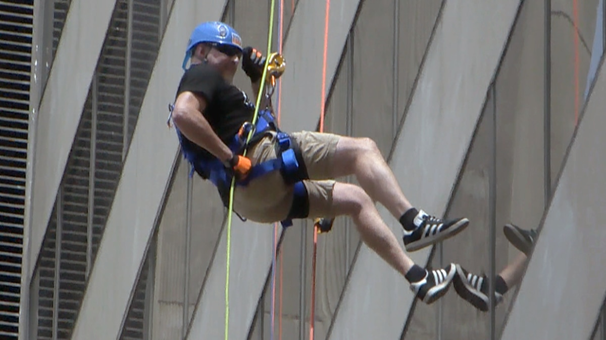 People who were able to raise at least $1,000 for Gilda's Club secured a spot to rappel down...
