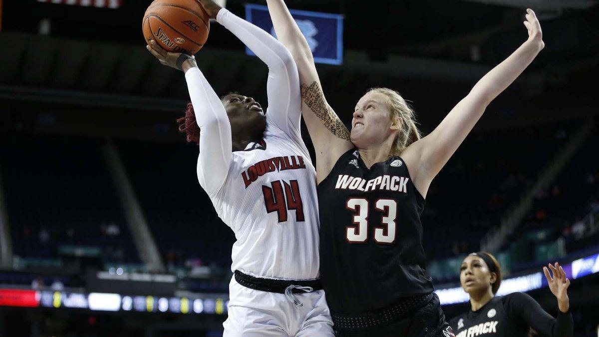 UofL freshman, Olivia Cochran battles in the paint