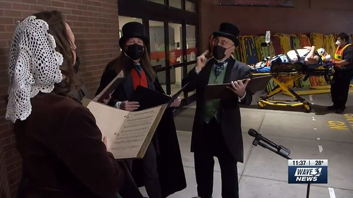 The quartet set up in front of the ambulance entrance to help bring a little cheer to those...