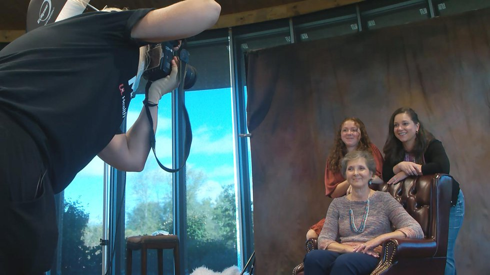 Joined by her granddaughter and her daughter, Cathy Kennedy had a photo taken of three...