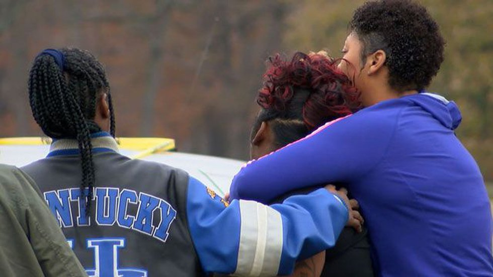 Loved ones hold close after the shootings at Shawnee Park. (Source: WAVE 3 News)
