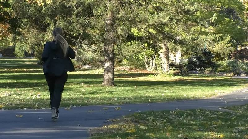Brittany Junck, a Mankato, Minn., resident and expecting mother, demonstrates her jogging...