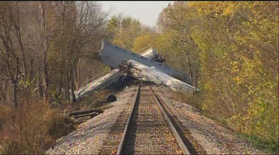 The derailed cars on the tracks.