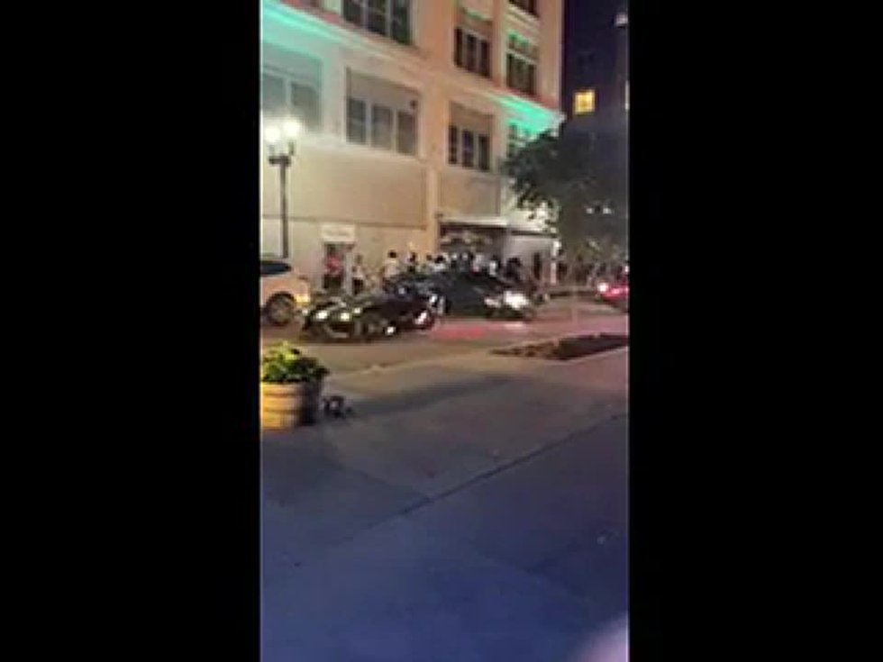 During a night of protests taking place in downtown Louisville, a large group gathered in front...