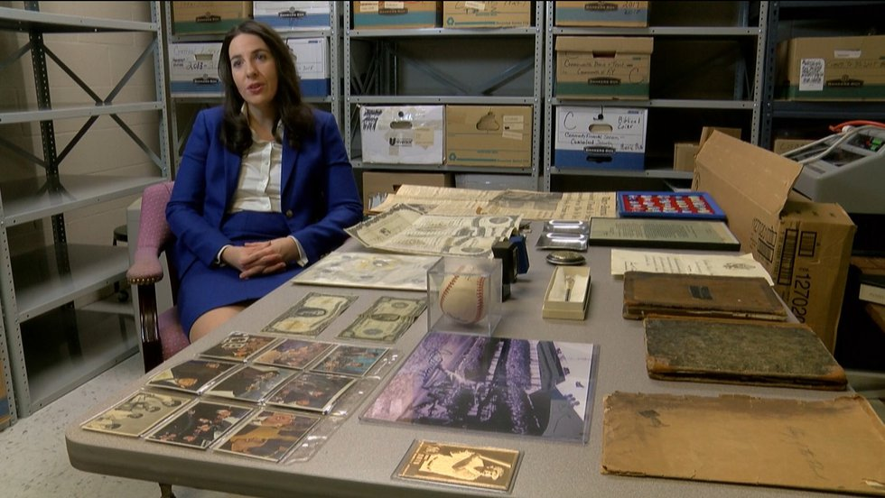 Kentucky Treasurer Allison Ball sits for an interview next to a variety of items on display in...