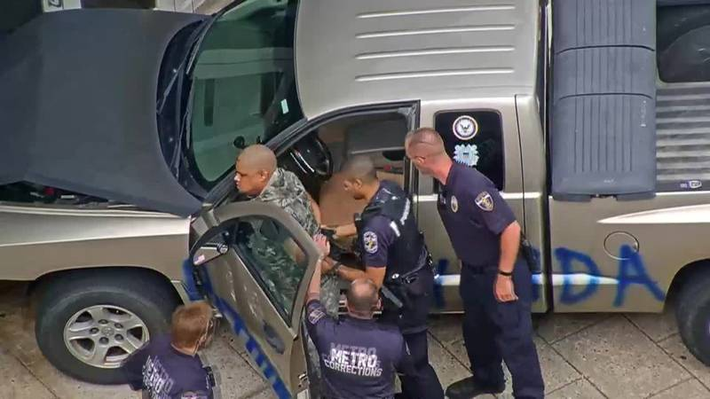 Newly-released video shows the moment of impact when a pickup truck crashed into the LMDC...