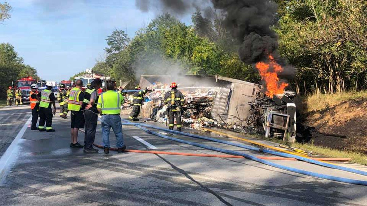 A semi filled with trash overturned and caught fire on Interstate 71 in Oldham County closing...