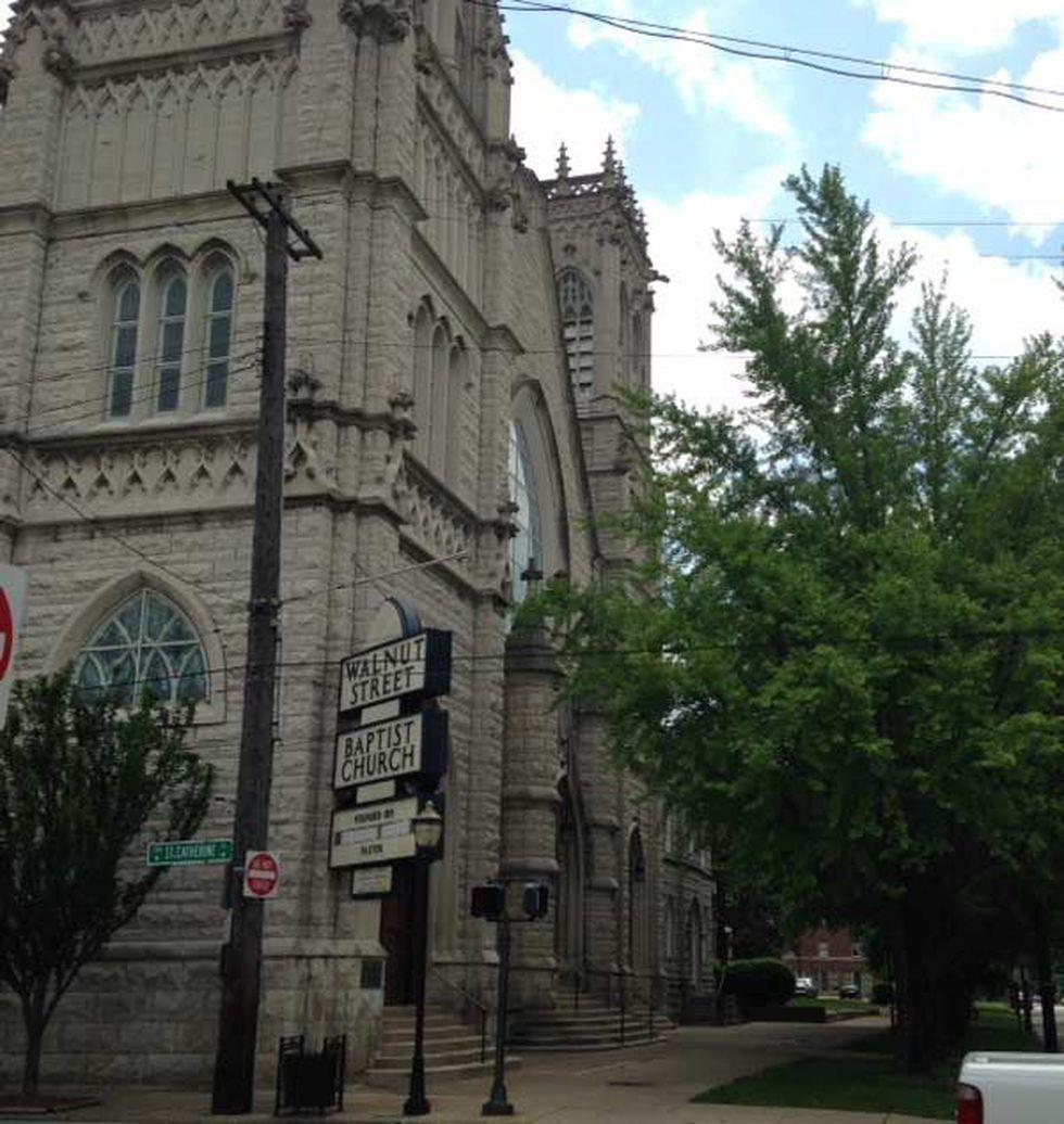 Gargoyles perched on the side of the Victorian gothic Walnut Street Baptist Church built around...