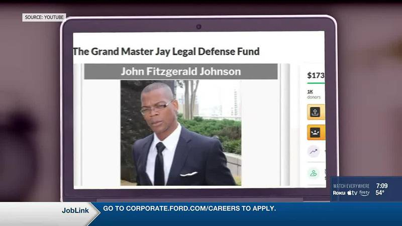 John Fitzgerald Johnson is accused of pointing a semi-automatic rifle at officers and a federal...