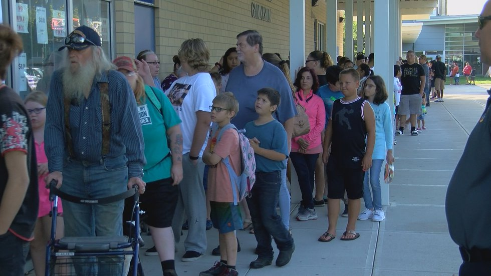 Dozens lined up outside Valley High to receive free school supplies, courtesy of JCPS.