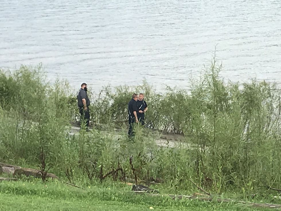 Crews are positioned along the shore and in the water. (Source: WAVE 3 News)