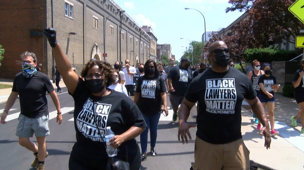 A group of black lawyers marched in Louisville calling for change.