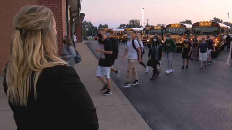 Students arrive at North Bullitt High School for the start of the 2021-22 school year wearing...