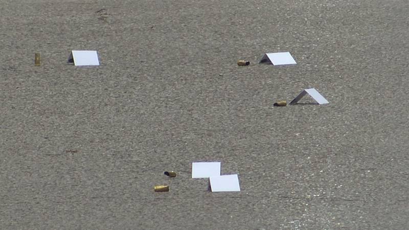 The locations of multiple shell casings along Barret Ave. near Highland Ave. are noted by...